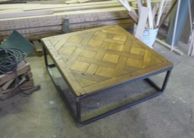 table made with an upcycled versailles parquetry floor piece