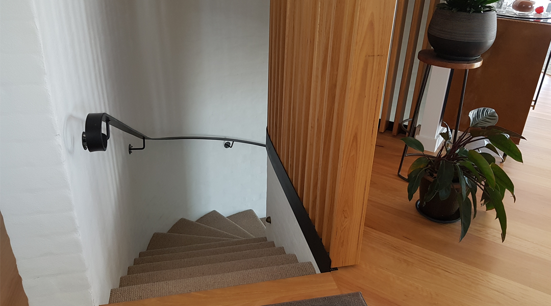 Steel and timber mid-century modern spiral stairs in Ocean Shores