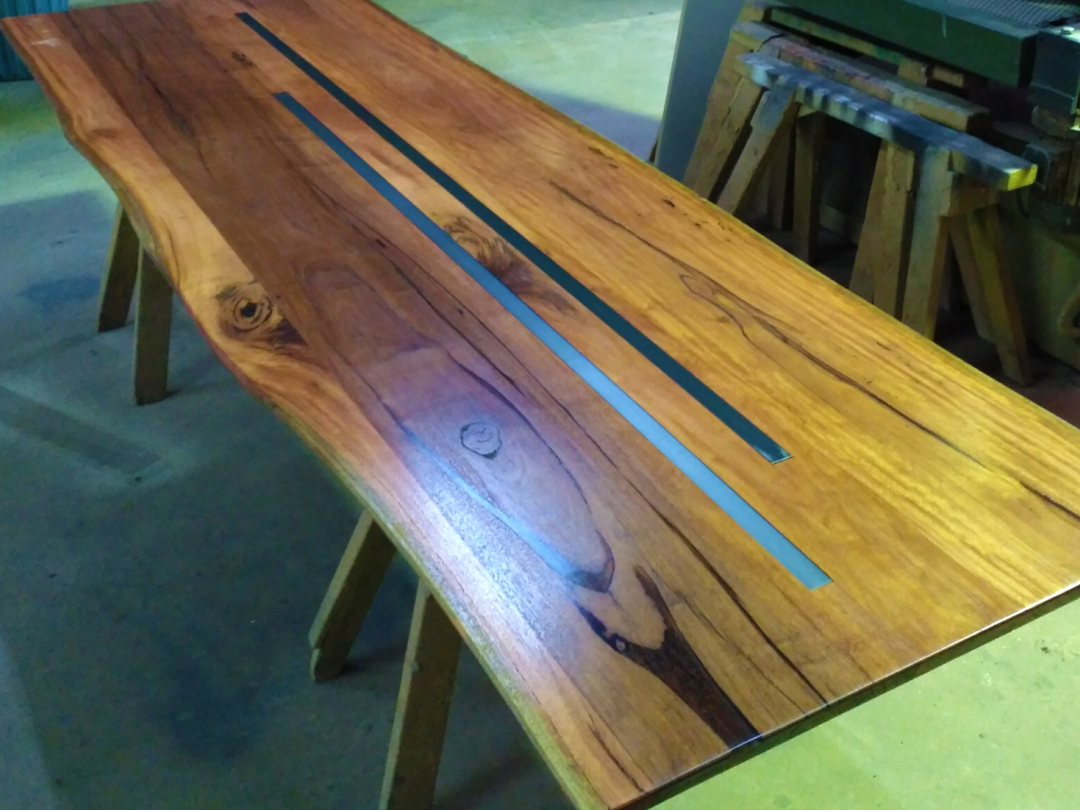 bloodwood timber slab bar table with steel insert