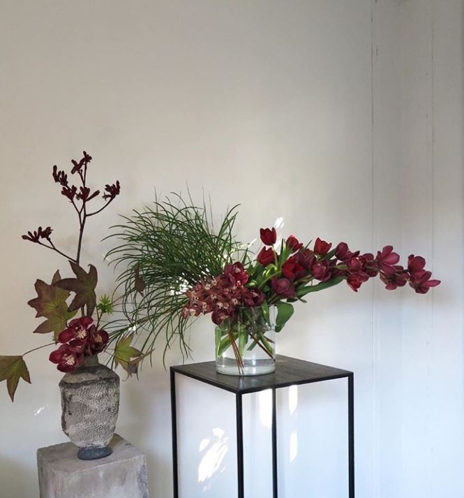 Braer floral design display plinths in black with red flowers