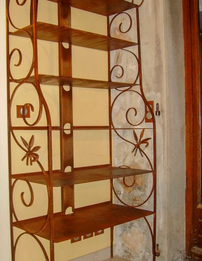 Boulangère traditional French-style bookshelf with hand forged wheat detail.